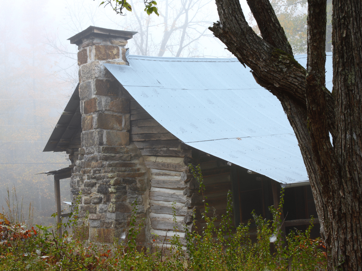 An old cabin on a foggy day in the mountains