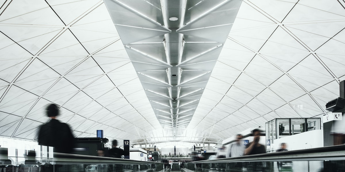 Passengers walking on the people mover in the airport